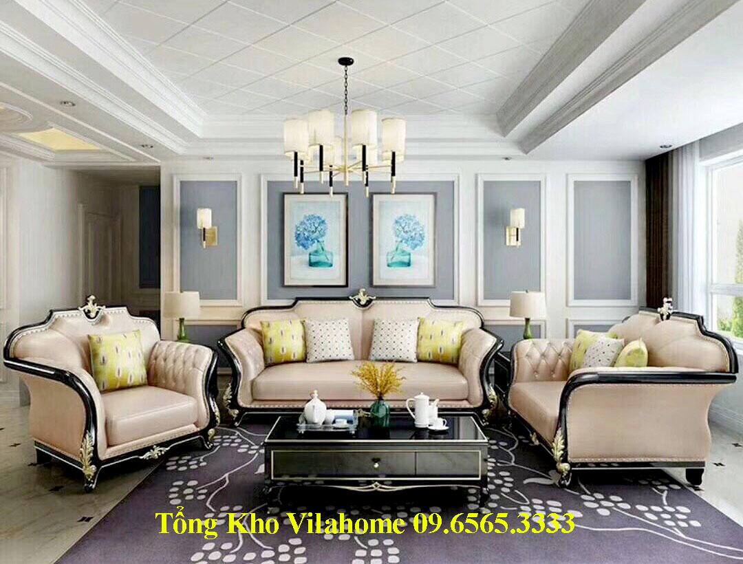 Sofa tân cổ điển bọc da màu kem khung uốn lượn sắc nét.